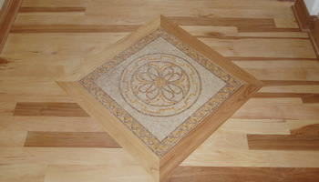 Mosaic tile accent in a wood floor